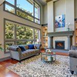 living room with large area rug hjun2 17 870x580